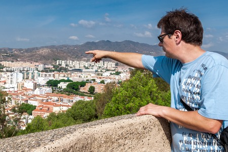 underlying: Tourist visiting the Alcazaba of Malaga  shows parts of the underlying city