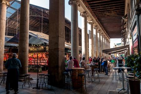 la boqueria: bustle and enjoyment at the Mercat St. Josep La Boqueria, Barcelona, Spain Editorial