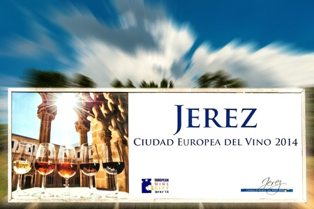 winegrowing: Advertising sign for the town of Jerez, Spain, as an European wine-growing town in 2014, with motion blur in the background