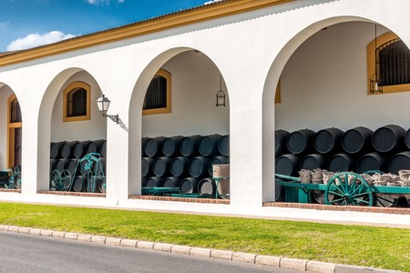 portico: Outside a Spanish bodega with portico and wooden barrels Editorial