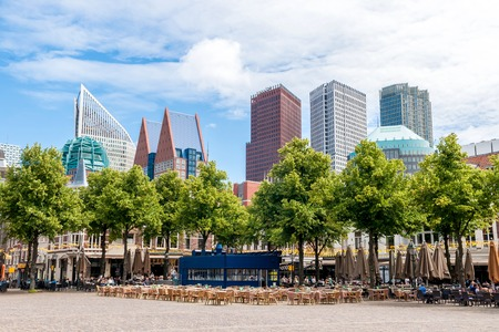 plein: Het Plein - the large square in The Hague with numerous bistros and restaurants, in the background the modern architecture around the main railway station