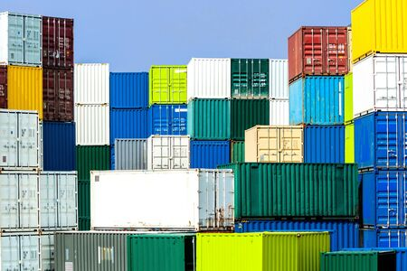 harmonious: Shipping container stack in diverse, harmonious colors in a port