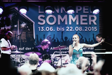 folk music: Remscheid-Lennep, Germany - July 11th, 2015: music event of Stefanie Hertel, well-known German folk music singer, with her band in the old town as a part of a row of summery cultural presentations