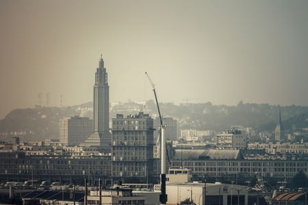 postwar: Hazy View from sea to the modern concrete - City architecture of Le Havre with the tower of the Church of St. Joseph, Unesco World Heritage Site, Normandy, France Stock Photo