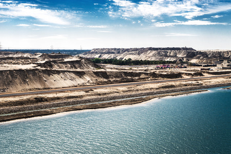 The Suez Canal and the in August 2015 newly opened Eastern Expansion Canal with raised sand masses, high-contrast picture