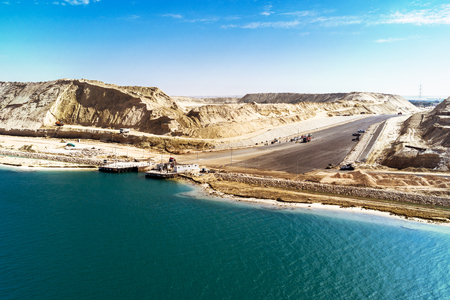 sinai desert: In the in August 2015 newly opened Eastern Expansion Canal of the Suez Canal with a view of the excavated sand masses and an access road to a ferry dock
