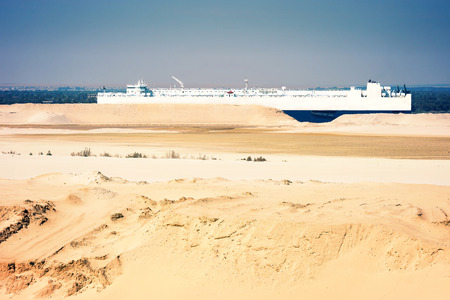 sinai desert: Desert ship - freightship traverses the Suez Canal in the direction of the Red Sea,