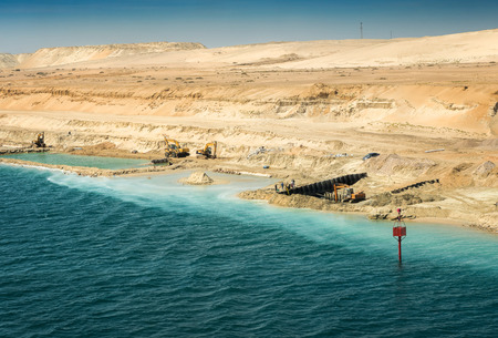Finishing of remaining construction works on the new expansion channel of the Suez Canal, opened in August 2015