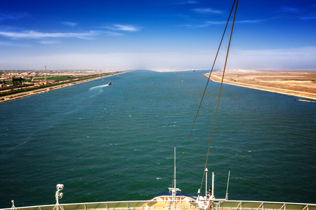 The Suez Canal at Port Said with the 2 exits to the Mediterranean Sea, in the foreground a ships bow with rail Stock Photo