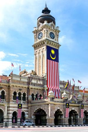 Sultan Abdul Samad Building with clock-tower and malaysian flag, Kuala Lumpur, Malaysia