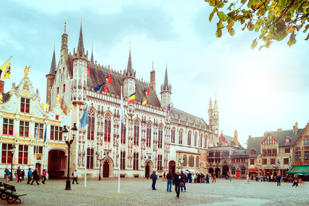Bruges, Belgium - September 22nd, 2014: The Castle Square with Old Chancery, town hall and Holy Blood Basilica Editorial