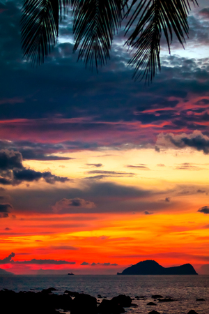 Colorful sunset in the famous Damai Bay in south-west Borneo, Malaysia, portrait format