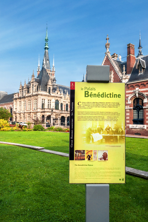 Fecamp  Normandy, France - September 23rd, 2014: View from the street on the Palais B?n?dictin with outbuildings and gardens, in the foreground on information board for tourists. Editorial