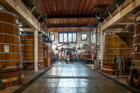 Fecamp  Normandy, France - September 23rd, 2014: Distilling plants and barrels for the maturation of the spirits of the famous Palais B?n?dictine.