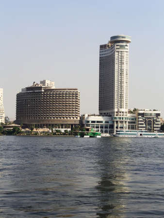 River Nile bank with a background of modern buildings on a sunny summer day, Cairo, Egypt