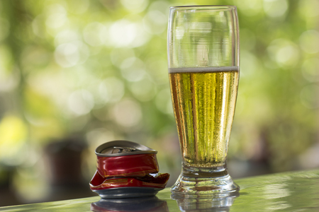 Glass of cold beer on the table and unfocused background