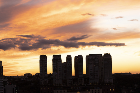 Beautiful sunset between the buildings of the big city Stock Photo