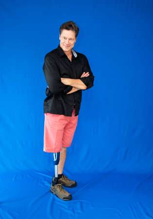 Mature man, physically disabled, leaning on his prosthesis.