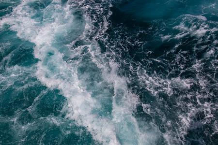 Ocean surface, sea foam on blue ocean, background