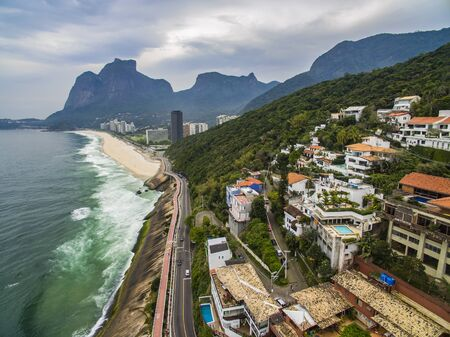 Bicycle and road track and next to the blue sea in the city of Rio de Janeiro. Tim Maia bike path on Niemeyer Avenue, Rio de Janeiro, Brazil, South America. Banque d'images - 143082344