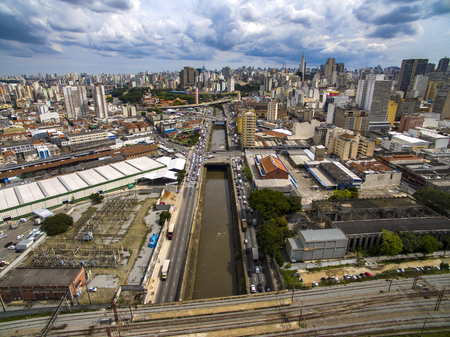 Great cities, great avenues, houses and buildings. Light district (Bairro da Luz), Sao Paulo Brazil, South America. Rail and subway trains. Aerial view of State Avenue next to the Tamanduatei River Banco de Imagens