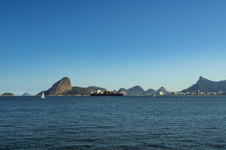Wonderful city, city of Rio de Janeiro, Sugar Loaf and the oil and gas tower in the background, Offshore oil industry. Brazil, South America. Copy space for advertising.