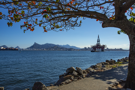 Wonderful city, city of Rio de Janeiro, Christ the Redeemer or Corcovado mountain and the oil and gas tower in the background, Offshore oil industry. Brazil, South America. Copy space for advertising.