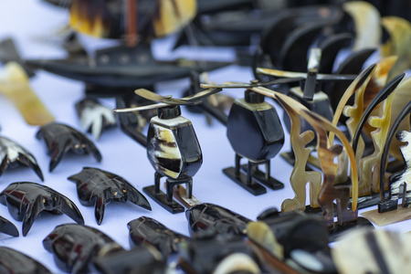 Jewelry in helicopter format. Jewelry made of cow horn. Banque d'images - 113714125
