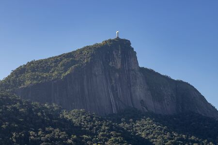 Wonderful city and symbol. Low angle view of the statue of Christ the Redeemer in Rio de Janeiro, Brazil. Religious symbol of Christianity and a modern wonder of the world.