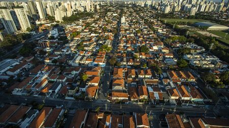 Roofs different from houses. View of the different red roofs of houses.