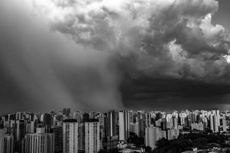 Beautiful view of the dramatic dark stormy sky in black and white. The rain is coming soon. Pattern of the clouds over city. Very heavy rain sky in Sao Paulo city, Brazil South America.