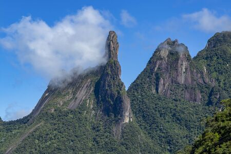 Clouds in the mountains. Exotic Mountains. Wonderful Mountains. Mountain Finger of God, the city of Teresopolis, State of Rio de Janeiro, Brazil, South America. Stok Fotoğraf