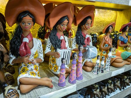 Clay dolls. Colorful clay dolls. With a selective focus on a doll.
