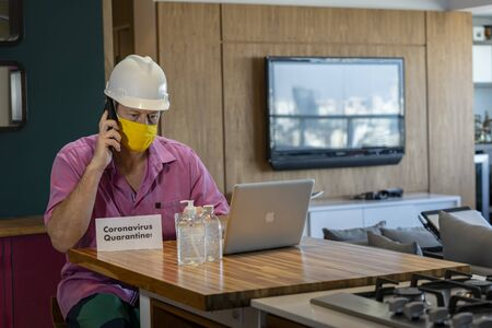 Concept of coronavirus quarantine. Man with a medical face mask using the phone to search for a Job. Banque d'images - 145892496