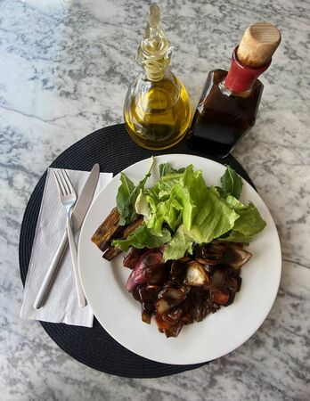 Healthy food dish. Olive oil and balsamic vinegar.