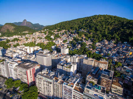 The contrast between rich and poor. City of Rio de Janeiro, Copacabana district and Canta Galo slum, Brazil. Imagens