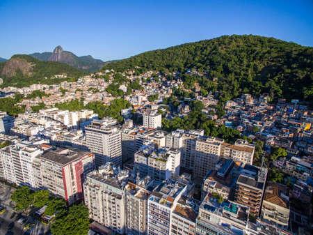 The contrast between rich and poor. City of Rio de Janeiro, Copacabana district and Canta Galo slum, Brazil. Stok Fotoğraf