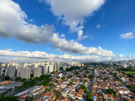 Panoramic view of the city of Sao Paulo, Brazil. Building in the district Itaim Bibi and houses in Brooklyn district.