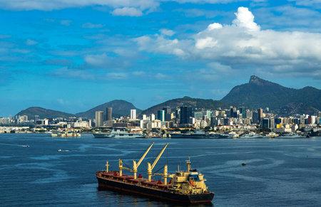 Cargo ship in a large city. Cargo ship in Guanabara Bay, Rio de Janeiro. Brazil.