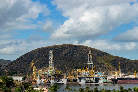 Oil refinery towers in the port. Niteroi city, Rio de Janeiro state, Brazil. Stok Fotoğraf