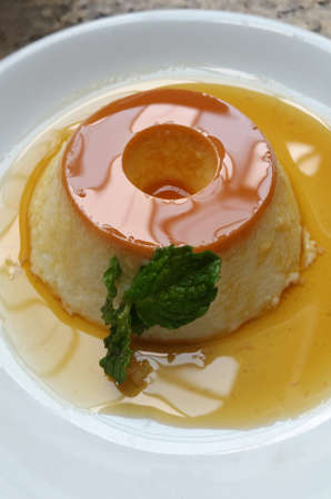 Homemade caramel cream pudding with mint.