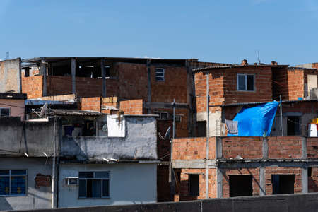 Poor architecture. Redbrick slum houses. Imagens - 165601029