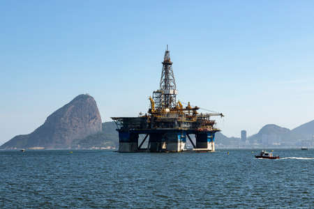 Oil from Brazil. Oil drilling rig against the panorama of Rio de Janeiro.