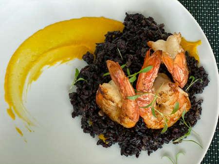 Gourmet food. Shrimp with black rice. Stok Fotoğraf - 165878125
