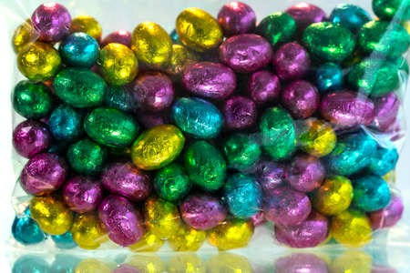 Colorful chocolate easter eggs. A pile of colorful chocolate Easter Eggs.