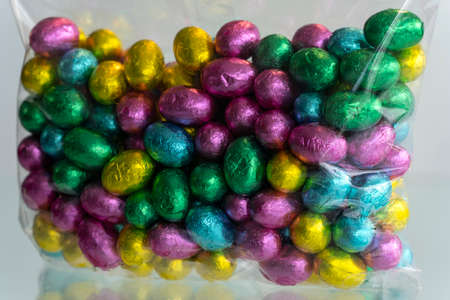 Many colors together. Chocolate candies. Colors background. Imagens - 166965301