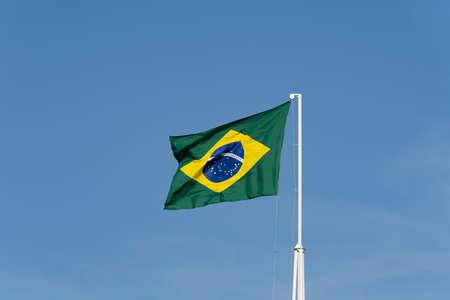 Brazils flag. Flag of Brazil in the wind. Imagens - 167318251