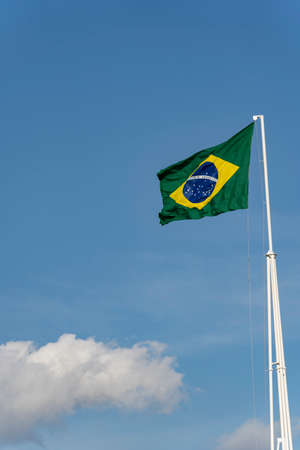Brazils flag. Flag of Brazil in the wind. Imagens - 167318268