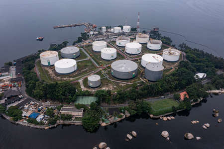 Aerial view of storage tanks at an oil refinery. Oil manufacturing products. Redactioneel