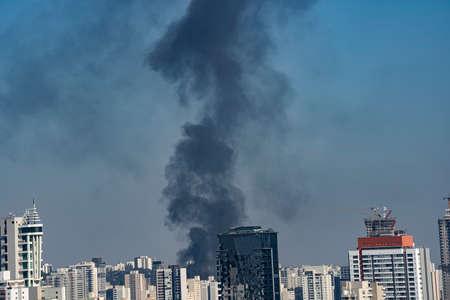 Black smoke in a city. Sao Paulo Brazil.